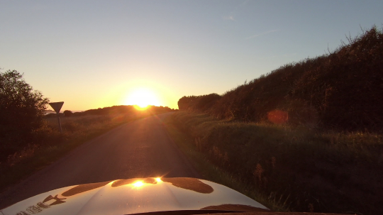 car on land road on a sunny afternoon at sunset, first person pov shot : Stock Photo or Stock Video Download rcfotostock photos, images and assets rcfotostock | RC-Photo-Stock.: