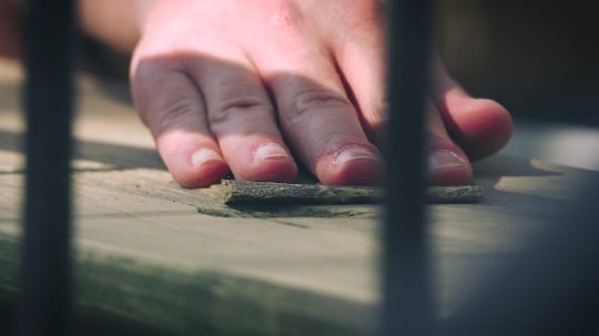 Close up of adult man caring about his outdoor furniture - handmade grinding with abrasive paper. Close up shot.  : Stock Photo or Stock Video Download rcfotostock photos, images and assets rcfotostock | RC-Photo-Stock.: