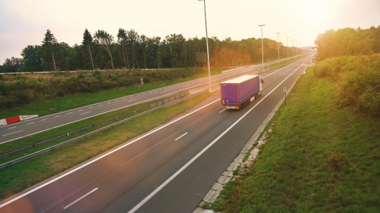 Commercial Truck with Cargo Trailer drives through empty Highway. Truck is White and blue. Sun shining in the background : Stock Photo or Stock Video Download rcfotostock photos, images and assets rcfotostock | RC-Photo-Stock.: