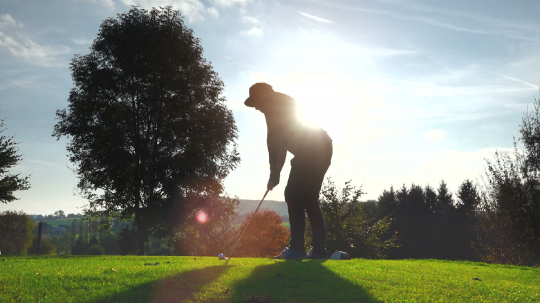 Golf Player plays golf on a beautiful summer morning. wide angle Lens flare Back lite shot  : Stock Photo or Stock Video Download rcfotostock photos, images and assets rcfotostock | RC-Photo-Stock.: