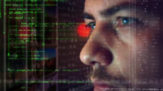Male hacker working on a computer for cyber attack while green binary hacking code characters reflect on his face in a dark office room - industry 4.0 concept : Stock Photo or Stock Video Download rcfotostock photos, images and assets rcfotostock | RC-Photo-Stock.: