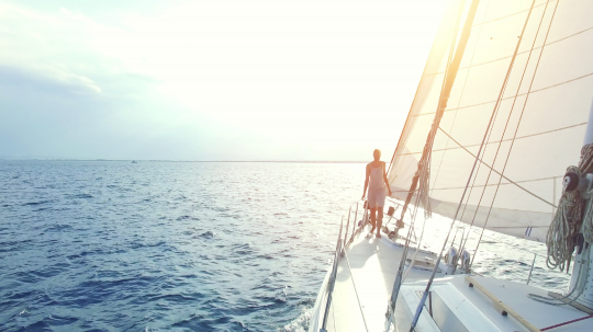 woman on big sailing boat or yacht on ocean at sunset : Stock Photo or Stock Video Download rcfotostock photos, images and assets rcfotostock | RC-Photo-Stock.: