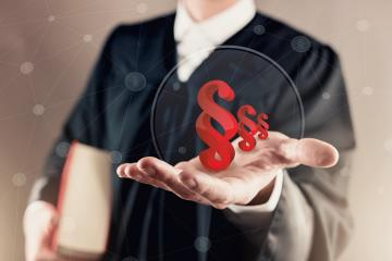 judge in a courtroom present paragraph signs on his hand - law justice concept image- Stock Photo or Stock Video of rcfotostock | RC-Photo-Stock