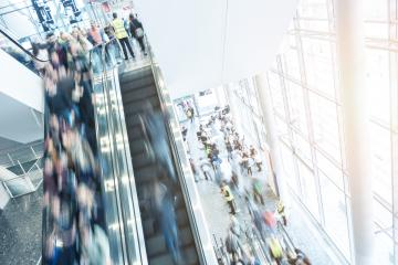 people using a staircase at  a tradeshow- Stock Photo or Stock Video of rcfotostock | RC-Photo-Stock
