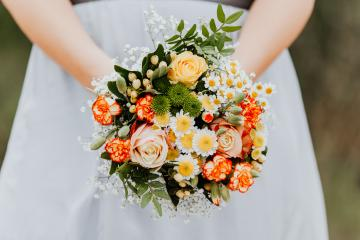 A bride with white dress is holing a wedding colorful bouquet of orange, yellow and green flowers. Close up. Wedding day. : Stock Photo or Stock Video Download rcfotostock photos, images and assets rcfotostock   RC-Photo-Stock.: