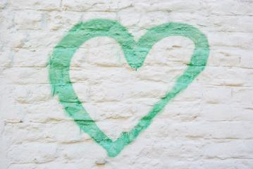 A green heart painted on a distressed white brick wall.- Stock Photo or Stock Video of rcfotostock | RC-Photo-Stock