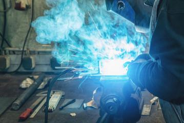 A man welder with construction gloves and a welding mask hard work and welds with a welding machine metal in workshop, close up : Stock Photo or Stock Video Download rcfotostock photos, images and assets rcfotostock | RC-Photo-Stock.: