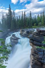 A rainbow appearing through the spray of Athabasca Falls : Stock Photo or Stock Video Download rcfotostock photos, images and assets rcfotostock | RC-Photo-Stock.: