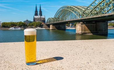 A Traditional beer (Kölsch) at Cologne with cathedral and hohenzollern bridge- Stock Photo or Stock Video of rcfotostock | RC-Photo-Stock