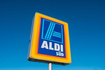 AAACHEN, GERMANY JANUARY, 2017: Aldi Süd logo against blue sky in germany  The German-based discount supermarket chain currently operates over 10,000 stores.- Stock Photo or Stock Video of rcfotostock | RC-Photo-Stock