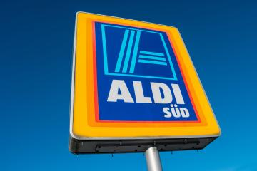 AAACHEN, GERMANY JANUARY, 2017: Aldi Süd logo against blue sky in germany  The German-based discount supermarket chain currently operates over 10,000 stores. : Stock Photo or Stock Video Download rcfotostock photos, images and assets rcfotostock | RC-Photo-Stock.: