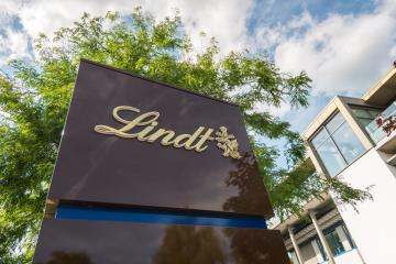 AACHEN, GERMANY APRIL, 2017: Lindt company logo. Lindt is a brand of the Lindt & Sprungli AG - a Swiss company, founded in 1845.- Stock Photo or Stock Video of rcfotostock | RC-Photo-Stock