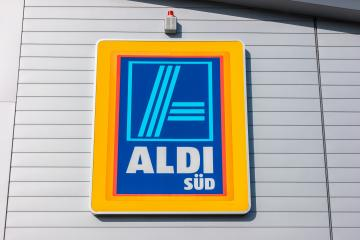 AACHEN, GERMANY FEBRUARY, 2017: Aldi sign (south division) against blue sky. Aldi is a leading global discount supermarket chain with almost 10,000 stores in 18 countries.- Stock Photo or Stock Video of rcfotostock | RC-Photo-Stock