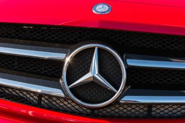 AACHEN, GERMANY FEBRUARY, 2017: Mercedes Benz logo on a red car grill. Mercedes-Benz is a German automobile manufacturer. The brand is used for luxury automobiles, buses, coaches and trucks.- Stock Photo or Stock Video of rcfotostock | RC-Photo-Stock