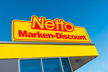 AACHEN, GERMANY FEBRUARY, 2017: Netto discount store against blue sky. It is part of Edeka Group, largest German supermarket corporation employing 250,000 people.- Stock Photo or Stock Video of rcfotostock | RC-Photo-Stock