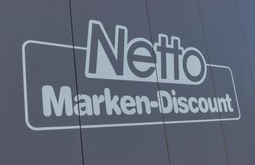 AACHEN, GERMANY FEBRUARY, 2017: Netto discount store Sign. It is part of Edeka Group, largest German supermarket corporation employing 250,000 people. : Stock Photo or Stock Video Download rcfotostock photos, images and assets rcfotostock   RC-Photo-Stock.: