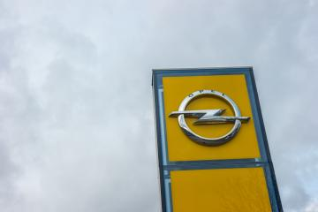 AACHEN, GERMANY FEBRUARY, 2017: Opel official dealership logo over cloudy Sky. Opel AG is a German automobile manufacturer and a subsidiary of the American General Motors Company.- Stock Photo or Stock Video of rcfotostock | RC-Photo-Stock