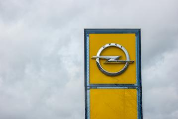 AACHEN, GERMANY FEBRUARY, 2017: Opel official dealership logo over cloudy Sky. Opel AG is a German automobile manufacturer.- Stock Photo or Stock Video of rcfotostock | RC-Photo-Stock