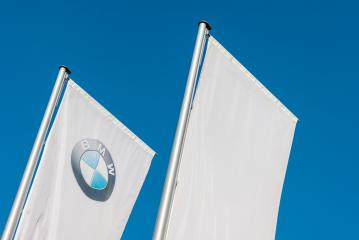 AACHEN, GERMANY FEBRUARY, 2017: Sign of a BMW logo on white flags. BMW is a vehicle, motorcycle, and engine manufacturing company from Munich, Bavaria, Germany.- Stock Photo or Stock Video of rcfotostock | RC-Photo-Stock