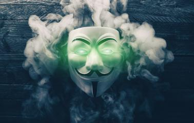 AACHEN, GERMANY FEBRUARY, 2017: Vendetta mask with light eyes and smoke on wooden background. This mask is a well-known symbol for the online hacktivist group Anonymous- Stock Photo or Stock Video of rcfotostock | RC-Photo-Stock