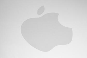 AACHEN, GERMANY FEBRUARY, 2017: White Apple logo on brushed aluminium background. Apple is the world's largest publicly traded company designs and sells consumer electronics and computer products.- Stock Photo or Stock Video of rcfotostock | RC-Photo-Stock
