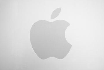 AACHEN, GERMANY FEBRUARY, 2017: White Apple logo on brushed aluminium background. Apple is the world's largest publicly traded company designs and sells consumer electronics and computer products. : Stock Photo or Stock Video Download rcfotostock photos, images and assets rcfotostock | RC-Photo-Stock.: