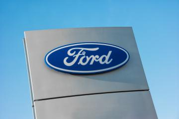 AACHEN, GERMANY JANUARY, 2017: Ford dealer sign against blue sky. The Ford Motor Company is an American multinational automaker founded by Henry Ford in 1903.- Stock Photo or Stock Video of rcfotostock | RC-Photo-Stock