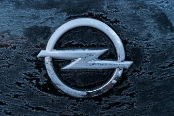 AACHEN, GERMANY JANUARY, 2017: Frozen Opel logo on a car. Opel AG is a German automobile manufacturer.- Stock Photo or Stock Video of rcfotostock | RC-Photo-Stock