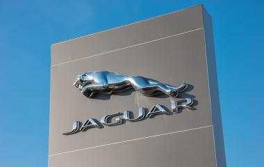 AACHEN, GERMANY JANUARY, 2017: Jaguar Logo against blue sky. Jaguar/Land Rover is a British multinational car manufacturer headquartered in Whitley, Coventry, England, owned byTata Motors since 2008.- Stock Photo or Stock Video of rcfotostock | RC-Photo-Stock