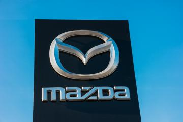 AACHEN, GERMANY JANUARY, 2017: Mazda dealership sign against blue sky. Mazda is a Japanese automaker and produces over 1 million vehicles per year.- Stock Photo or Stock Video of rcfotostock | RC-Photo-Stock