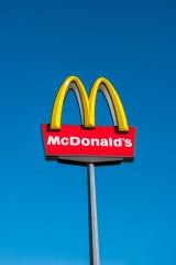 AACHEN, GERMANY JANUARY, 2017: McDonald's restauraunt sign in germany against blue sky. The McDonald's Corporation is the world's largest chain of hamburger fast food restaurants.- Stock Photo or Stock Video of rcfotostock | RC-Photo-Stock