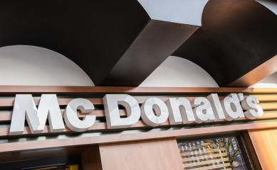 AACHEN, GERMANY JANUARY, 2017: McDonalds logo sign. It is the world's largest chain of hamburger fast food restaurants.- Stock Photo or Stock Video of rcfotostock | RC-Photo-Stock