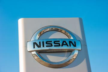 AACHEN, GERMANY JANUARY, 2017: Nissan automobile dealership Sign. Nissan Motor Corporation is a Japanese multinational automobile manufacturer headquartered in Nishi-ku, Yokohama, Japan.- Stock Photo or Stock Video of rcfotostock | RC-Photo-Stock