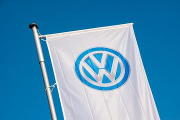 AACHEN, GERMANY JANUARY, 2017: Sign of a Volkswagen logo on a flag. Volkswagen is a German automobile manufacturer and the biggest German automaker and the third largest automaker in the world.- Stock Photo or Stock Video of rcfotostock | RC-Photo-Stock