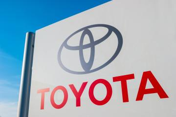 AACHEN, GERMANY JANUARY, 2017: Toyota dealership sign against blue sky. Toyota is the world's market leader in sales of hybrid electric vehicles.- Stock Photo or Stock Video of rcfotostock | RC-Photo-Stock