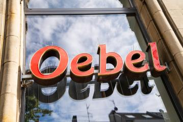 AACHEN, GERMANY JULY 2019:  Oebel bakery Store Logo. Headquartered in Aachen, Oebel is a bakery company since 1918, with bakeries and bakery cafes in Aachen and around NRW.- Stock Photo or Stock Video of rcfotostock | RC-Photo-Stock