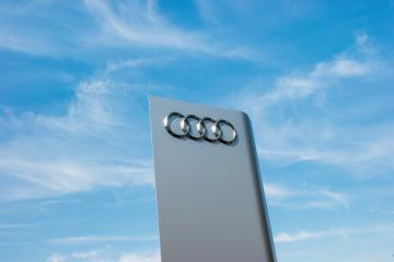 AACHEN, GERMANY MARCH, 2017: Audi dealership logo against blue sky. Audi is a German automobile manufacturer that designs, engineers, produces, markets and distributes luxury automobiles.- Stock Photo or Stock Video of rcfotostock | RC-Photo-Stock