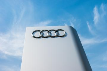 AACHEN, GERMANY MARCH, 2017: Audi dealership sign against blue sky. Audi is a German automobile manufacturer that designs, engineers, produces, markets and distributes luxury automobiles.- Stock Photo or Stock Video of rcfotostock | RC-Photo-Stock
