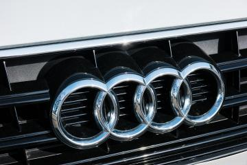 AACHEN, GERMANY MARCH, 2017: Audi emblem on a car grill. Audi is a German automobile manufacturer that designs, engineers, produces, markets and distributes luxury automobiles- Stock Photo or Stock Video of rcfotostock   RC-Photo-Stock