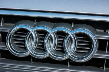 AACHEN, GERMANY MARCH, 2017: Audi emblem on a car grill. Audi is a German automobile manufacturer that designs, engineers, produces, markets and distributes luxury automobiles- Stock Photo or Stock Video of rcfotostock | RC-Photo-Stock
