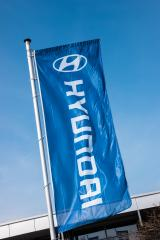 AACHEN, GERMANY MARCH, 2017: Hyundai flag against blue sky. Hyundai Motor Company is a South Korean multinational automotive manufacturer founded at 1967.- Stock Photo or Stock Video of rcfotostock | RC-Photo-Stock