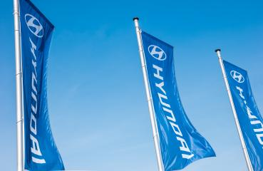 AACHEN, GERMANY MARCH, 2017: Hyundai flags against blue sky. Hyundai Motor Company is a South Korean multinational automotive manufacturer founded at 1967.- Stock Photo or Stock Video of rcfotostock | RC-Photo-Stock