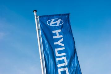 AACHEN, GERMANY MARCH, 2017: Hyundai logo on a flag. Hyundai Motor Company is a South Korean multinational automotive manufacturer founded at 1967. : Stock Photo or Stock Video Download rcfotostock photos, images and assets rcfotostock | RC-Photo-Stock.: