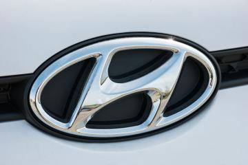 AACHEN, GERMANY MARCH, 2017: Hyundai logo on a white car. Hyundai Motor Company is a South Korean multinational automotive manufacturer founded at 1967. : Stock Photo or Stock Video Download rcfotostock photos, images and assets rcfotostock | RC-Photo-Stock.: