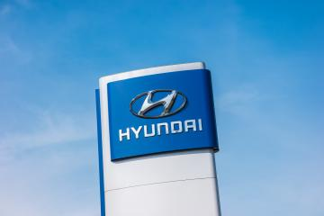 AACHEN, GERMANY MARCH, 2017: Logotype of Hyundai corporation over blue Sky.  Hyundai is the South Korea's automotive manufacturer.- Stock Photo or Stock Video of rcfotostock | RC-Photo-Stock