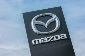 AACHEN, GERMANY MARCH, 2017: Mazda dealership sign against blue sky. Mazda is a Japanese automaker and produces over 1 million vehicles per year.- Stock Photo or Stock Video of rcfotostock   RC-Photo-Stock
