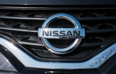 AACHEN, GERMANY MARCH, 2017: Nissan logo on a car grill. Nissan Motor Corporation is a Japanese multinational automobile manufacturer headquartered in Nishi-ku, Yokohama, Japan.- Stock Photo or Stock Video of rcfotostock | RC-Photo-Stock