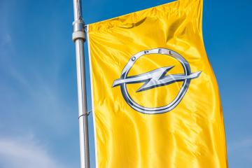 AACHEN, GERMANY MARCH, 2017: Opel flag closeup against blue sky at the Opel Store. Opel AG is a German automobile manufacturer.- Stock Photo or Stock Video of rcfotostock | RC-Photo-Stock
