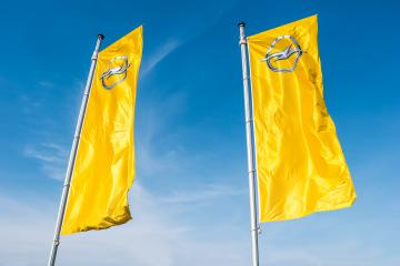 AACHEN, GERMANY MARCH, 2017: Opel flags against blue sky at the Opel Store. Opel AG is a German automobile manufacturer.- Stock Photo or Stock Video of rcfotostock | RC-Photo-Stock