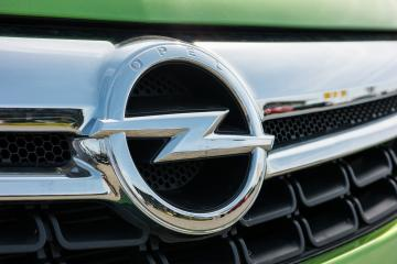 AACHEN, GERMANY MARCH, 2017: Opel logo on a green car. Opel AG is a German automobile manufacturer.- Stock Photo or Stock Video of rcfotostock | RC-Photo-Stock